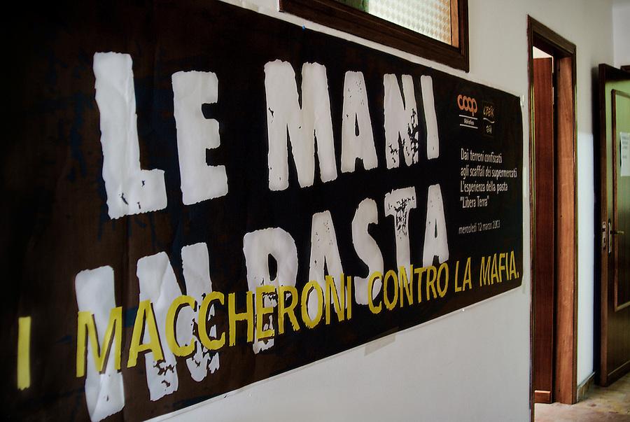 In the Libera Terra headquarters. / La sede delle cooperative.