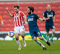 20th March 2021; Bet365 Stadium, Stoke, Staffordshire, England; English Football League Championship Football, Stoke City versus Derby County; Joe Allen of Stoke City under pressure from  Graeme Shinnie of Derby County