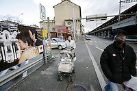 """Switzerland. Geneva. Poverty in Geneva. A mother walks and her baby daughter in a stroller in the """"Grottes"""" area. Both are swiss and have been living for the last three months in the shelter """" Au Coeur des Grottes"""" which is ran by the Salvation Army and is located in the Grottes area. The place is solely reserved for women, mothers and children with social problems. Model Released. © 2005 Didier Ruef"""