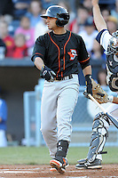 Delmarva Shorebirds third baseman Jason Esposito #9 swings at a pitch during a game between the Delmarva Shorebirds and the Asheville Tourists at McCormick Field, Asheville, North Carolina April 6, 2012. The Shorebirds won the game 7-2  (Tony Farlow/Four Seam Images)..