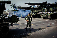 A Cuban Revolutionary Armed Forces (FAR) soldier guards Soviet made mobile missile launchers the day before a parade marking the 50th anniversary of the landing of Granma and a celebration for Fidel Castro's 80th birthday in Havana, Cuba on 1 December 2006. Castro's original birthday celebration was delayed for three and a half months due to poor health.