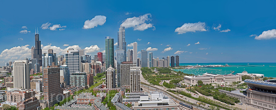 This is the beautiful Chicago Skyline as seen from the near south side.  This is a stitch of numerous photos seamlessly stitched together so the clarity of the image is astonishing.  When enlarged, the score of the Bears and Packers on the Soldier Field scoreboard is visible.  The famous Buckingham Fountain is shooting off as it does every hour, on the hour during the summer months.  Banners on the entrance to the Field Museum are also clearly visible.