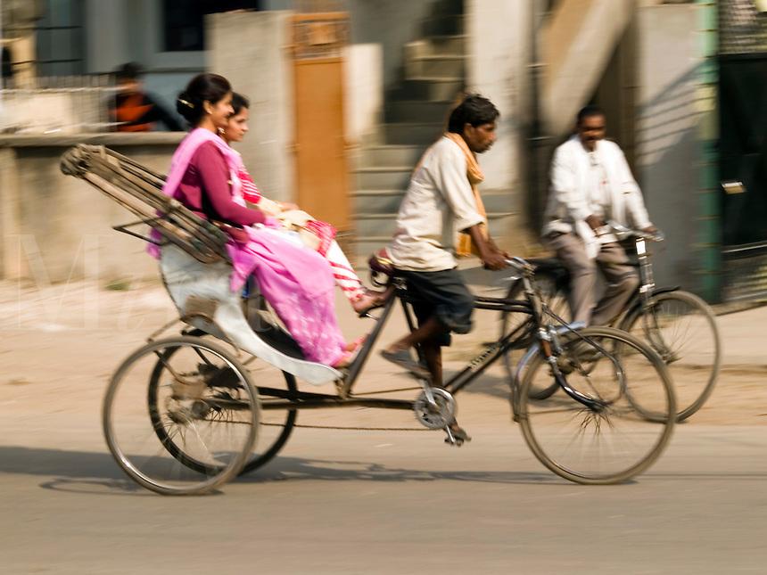A bicycle rickshaw at work in Varanasi, Uttar Pradesh, India