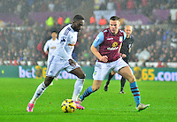 Pictured: Friday 26 December 2014<br /> Re: Premier League, Swansea City FC v Aston Villa at the Liberty Stadium, Swansea, south Wales, UK.<br /> <br /> Swansea's Nathan Dyer taking on Ciaran Clark