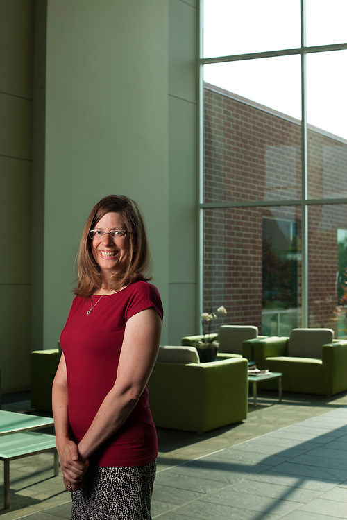 Cathy Singer heads Yahoo's Champaign office at the University of Illinois's research park. In December the company will move into a larger building, currently under construction, with more employees. photo by Kristen Schmid