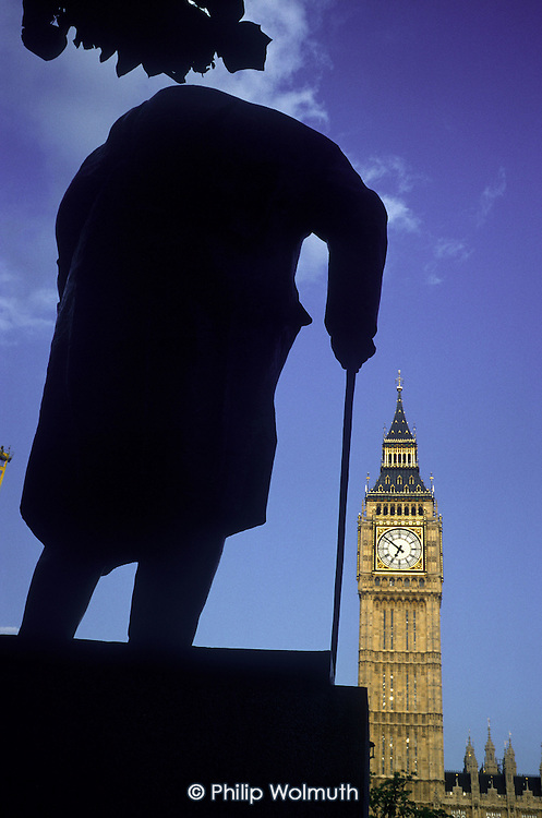 Statue of Churchill watches over Big Ben and the Houses of Parliament, London