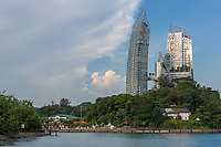 """Singapore. Juxtaposition of Old and New: Daniel Libeskind's """"Reflections"""" in Background vs. Harbourmaster's 1920-era House in foreground on right.  The apparent curvature in the highrise apartrment building is not a result of lens distortion."""