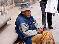 MAN SITTING ON STEPS IN CUZCO,PERU
