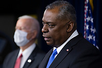 US Secretary of Defense Lloyd Austin (R) delivers remarks beside US President Joe Biden (L), to Department of Defense personnel, at the Pentagon in Arlington, Virginia, USA, 10 February 2021.<br /> CAP/MPI/RS<br /> ©RS/MPI/Capital Pictures