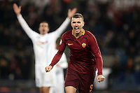 Calcio, Serie A: Roma vs ChievoVerona. Roma, stadio Olimpico, 22 settembre 2016.<br /> Roma's Edin Dzeko celebrates after scoring during the Italian Serie A football match between Roma and Chievo Verona, at Rome's Olympic stadium, 22 December 2016.<br /> UPDATE IMAGES PRESS/Isabella Bonotto