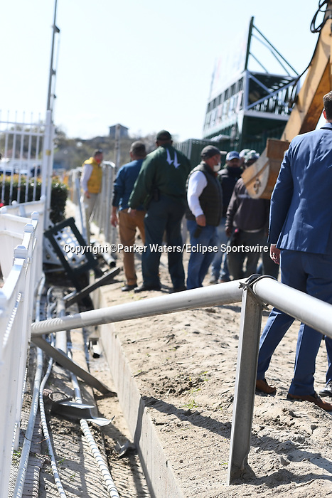March 20, 2021: The starting gate backs into a ditch, breaks through the railing and damages the fence while being moved between the ninth and tenth race during Louisiana Derby Day at Fair Grounds Race Course in New Orleans, Louisiana. Parker Waters/Eclipse Sportswire/CSM