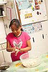9 year old girl making tortillas
