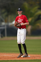 First baseman Tanner Elizondo (17) waits for a warmup throw in between innings during the Perfect Game National Underclass East Showcase on January 23, 2021 at Baseball City in St. Petersburg, Florida.  (Mike Janes/Four Seam Images)