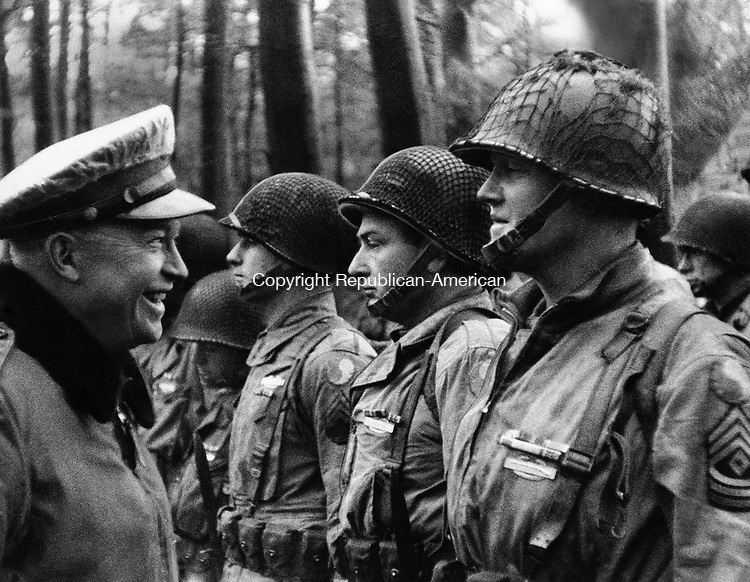 This is the scene censors viewed as the two-millionth foot of motion picture film reviewed since D-Day reached the screen at SHAEF film censorship theater and showed U.S. Gen, Dwight D. Eisenhower, Supreme Allied Commander, talking with men of the American Divison D-Day, June 6,1944. (AP Photo)