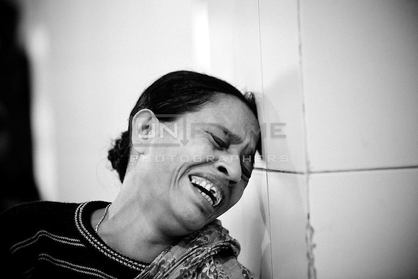 Halima Begum, waif of 60 years old Farid Meya, cries for her husband at DMCH. <br /> <br /> Bus driver Babul Mia, 40, and passengers Shahina Begum, 40, and Farid Mia, 60 have been injured. They have been admitted to the burn unit of Dhaka Medical College and Hospital.<br /> <br /> Some youths hurled a petrol bomb at the bus, said DMCH Police Outpost inspector Mozammel Haque quoting the bus driver.<br /> <br /> He quoted doctors as saying that Shahina had suffered 64 percent burns; Farid, 48; and Babul, eight percent.