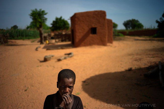 Boy stands outside a mud dwelling in Garin Saoude, Niger on Sept. 23, 2010. The population of Niger is hit yearly with a chronic food crisis that generally peaks between May and September.