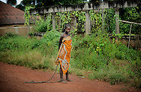 In Kerfey village near Lunsar, Sierra Leone, this mentally disturbed woman is chained to keep her from running away. The health facilities are inadequate, the nearest health centre is several kilometres away and has only one health assistant and not operation room. The nearest government lies on one of the worst roads of the country about two hours drive away.