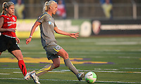 Philadelphia midfielder, Caroline Seger (9) evades Atlanta's McCall Zerboni (2) and passes the ball outside.  Atlanta and Philadelphia played to a 0-0 draw in the season opener for both teams at John A Farrell Stadium in West Chester, PA.