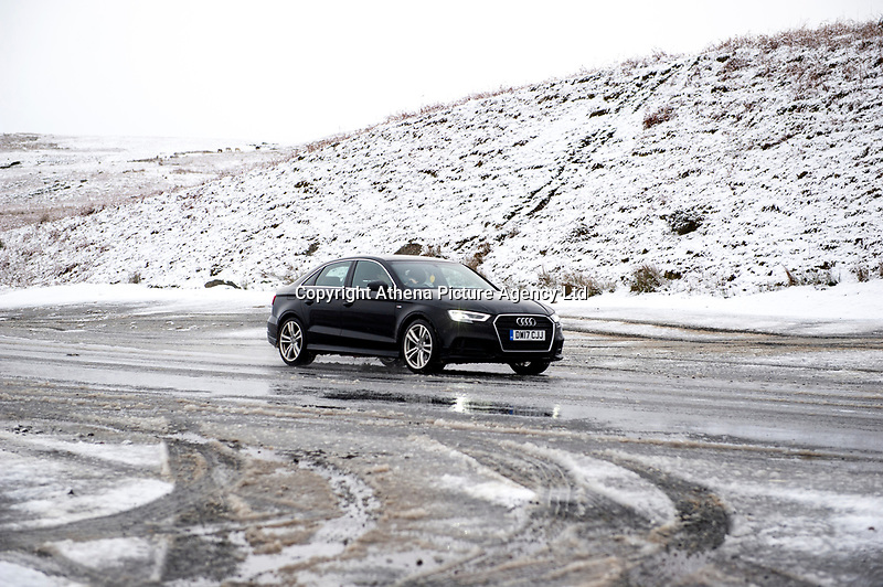 WEATHER PICTURE WALES<br /> Pictured: A car drives in the snow near Penderyn, in Powys, Wales, UK. Tuesday 29 January 2019<br /> Re: A Met Office yellow warning for snow and ice for the whole of Wales has came into force.