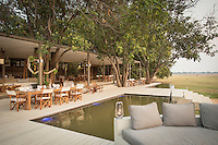 Chinzombo Safari Lodge swimming pool and eating area. Zambia, Africa