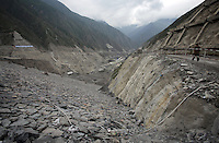 The drainage channel of the Maoergai Dam, a 147-metre high, clay-core, gravel dam located near Heishui town. The dam is one of 25,000 dams that make up China's hydropower network.