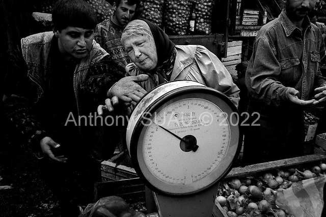 Moscow, Russia  .1998.In a big market just on the outskirts of Moscow a pensioner argues with a seller over the price of vegetables. Prices are very important to the pensioners, as the Russian government now owes them more than 20 billion rubles..