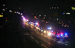 More than 100 emergency vehicles escort the family members of a Carson City Sheriff's deputy killed in the line of duty early Saturday to a candlelight vigil in Carson City, Nev., on Saturday, Aug. 15, 2015. Hundreds of residents came out to show their support for the family and department. <br /> Photo by Cathleen Allison
