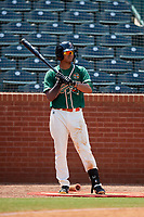 Greensboro Grasshoppers left fielder Jhonny Santos (21) on deck during a game against the Lakewood BlueClaws on June 10, 2018 at First National Bank Field in Greensboro, North Carolina.  Lakewood defeated Greensboro 2-0.  (Mike Janes/Four Seam Images)