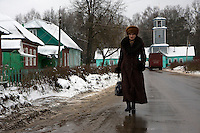 A woman walk past wooden houses in the town of Ludinovo, near the city of Kaluga southwest of Moscow. .Picture by Justin Jin.