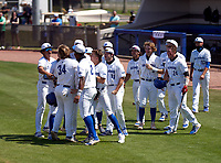 IMG Academy Ascenders Tommy White (34) celebrates hitting a home run with teammates - including Davion Hickson (6), Elijah Green (2), Max Galvin (17), Mason Albright (11) - during a game against the Calvary Christian Academy Eagles on March 13, 2021 at IMG Academy in Bradenton, Florida.  (Mike Janes/Four Seam Images)