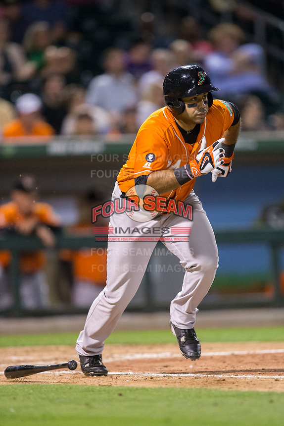 Pedro Alvarez (24) of the Norfolk Tides hustles down the first base line against the Charlotte Knights at BB&T BallPark on May 2, 2017 in Charlotte, North Carolina.  The Knights defeated the Tides 8-3.  (Brian Westerholt/Four Seam Images)