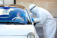 Rome April 4th 2020. Santa Maria della Pieta'. Coronavirus emergency.  Due to the spread of Covid-19 virus, Italy started a new procedure, a drive-through COVID-19 pharyngeal and nasal swab to test possible positivity to the infection . In the pictures, medical workers testing doctors and nurses of San Filippo Neri hospital. <br /> Photo Samantha Zucchi Insidefoto