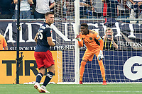 FOXBOROUGH, MA - AUGUST 8: Andre Blake #18 of Philadelphia Union sets the wall during a game between Philadelphia Union and New England Revolution at Gillette Stadium on August 8, 2021 in Foxborough, Massachusetts.