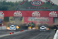 Sept. 1, 2012; Claremont, IN, USA: NHRA funny car driver Tim Wilkerson (left) races alongside Matt Hagan during qualifying for the US Nationals at Lucas Oil Raceway. Mandatory Credit: Mark J. Rebilas-