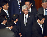 December 24, 2014, Tokyo, Japan - Former Defense Minister Gen Nakatani stands in line to cast his ballot in a process to elect Japan's new prime minister during a special Diet session convened in Tokyo on Wednesday, December 24, 2014. Shinzo Abe, re-elected as prime minister, is set to form a new Cabinet. Nakatani is expected to replace scandal-hit Akinori Eto.  (Photo by Natsuki Sakai/AFLO)