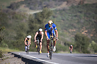 Matt Reed reaches the top of the climb during the Accenture Ironman California 70.3 in Oceanside, CA on March 29, 2014.