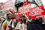 Tokyo, Japan - Fast-food workers protest for better payments and conditions around Shibuya district on May 15, 2014. The strike action is a part of a global movement of the International Union of Food (IUF), Agricultural, Hotel, Restaurant, Catering, Tobacco and Allied Worker's Associations. The strikes are launched on May 15 in different countries such as Brazil, USA, Italy, Morocco and Japan. (Photo by Rodrigo Reyes Marin/AFLO)