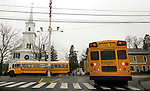 NEWTOWN, CT. 18 December 2012-121812SV02-School buses pass by the flagpole on Main Street in Newtown Tuesday. Newtown students returned to school today with the exception of Sandy Hook..Steven Valenti Republican-American
