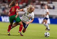 HOUSTON, TX - JUNE 10: Andreia Norton #8 of Portugal fouls Lindsey Horan #9 of the USWNT during a game between Portugal and USWNT at BBVA Stadium on June 10, 2021 in Houston, Texas.
