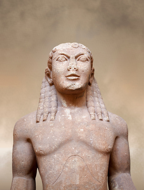 Archaic Ancient Greek marble statue of a Kouros, one of the Twins of Argos sculpted in the Argos archaic workshop circa 580 BC, Delphi National Archaeological Museum.