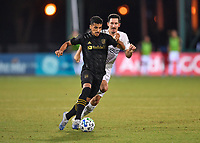 LAKE BUENA VISTA, FL - JULY 18: Mohamed El-Munir #13 of LAFC cuts in front of Sacha Klestan #16 of LA Galaxy during a game between Los Angeles Galaxy and Los Angeles FC at ESPN Wide World of Sports on July 18, 2020 in Lake Buena Vista, Florida.