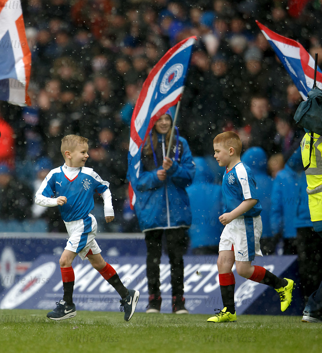 The two young mascots are first onto the pitch