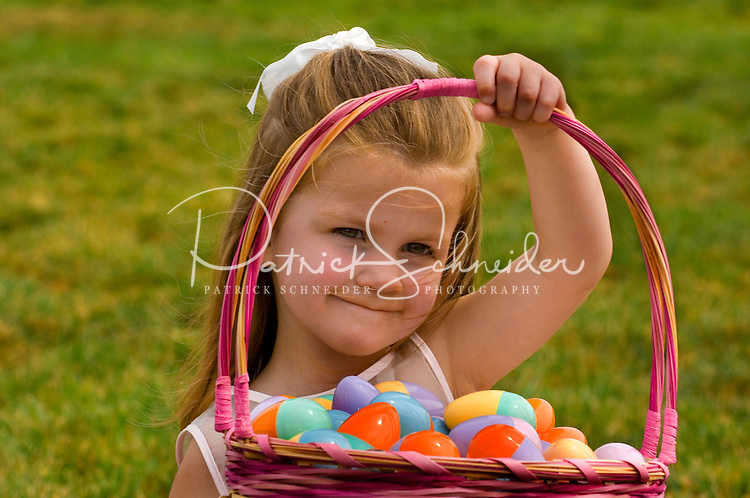 A young girl holds up a basket filled with Easter Eggs during a holiday party at Berewick master-planned community in southwest Mecklenburg County, Charlotte, NC. The property is developed by Pappas Properties.