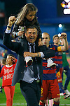 FC Barcelona's coach Luis Enrique Martinez celebrates with his daughter and Andres Iniesta (r) the victory in the Spanish Kings Cup Final match. May 22,2016. (ALTERPHOTOS/Acero)