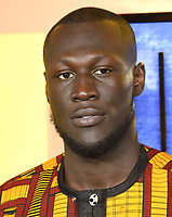 """Stormzy<br /> arriving for the """"Black Panther"""" premiere at the Hammersmith Apollo, London<br /> <br /> <br /> ©Ash Knotek  D3376  08/02/2018"""