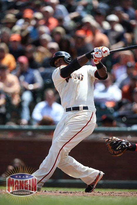 SAN FRANCISCO, CA - MAY 8:  Francisco Peguero #14 of the San Francisco Giants bats against the Philadelphia Phillies during the game at AT&T Park on Wednesday, May 8, 2013 in San Francisco, California. Photo by Brad Mangin