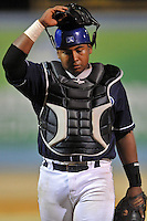 Asheville Tourists catcher Michael Ramirez #13 during a game against the West Virginia Power at McCormick Field on April 13, 2013 in Asheville, North Carolina. The Power won the game 14-9. (Tony Farlow/Four Seam Images).