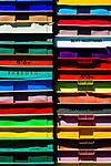Stack of multicolored plastic crates.