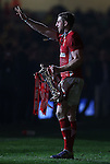 Wales try scoring hero Alex Cuthbert salutes the fans as he parades the 6 Nations trophy after Wales retain the Championship..2013 RBS 6 Nations Championship.Wales v England.Millennium Stadium.16.03.13.Credit: Steve Pope- Sportingwales