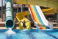 A man takes a water slide at the Adin Beach hotel in southern Turkey. The hotel is halal friendly, meaning that there are gender segregated areas, no alcohol, and modest clothing requirements.